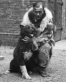 A black and white image of Gunnar Kaasen and Balto, the sled dog.